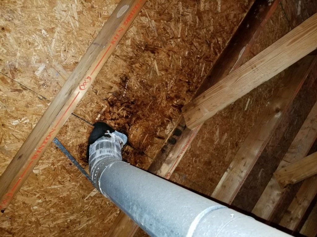 picture of a vent pipe too close to the roof found on a home inspection