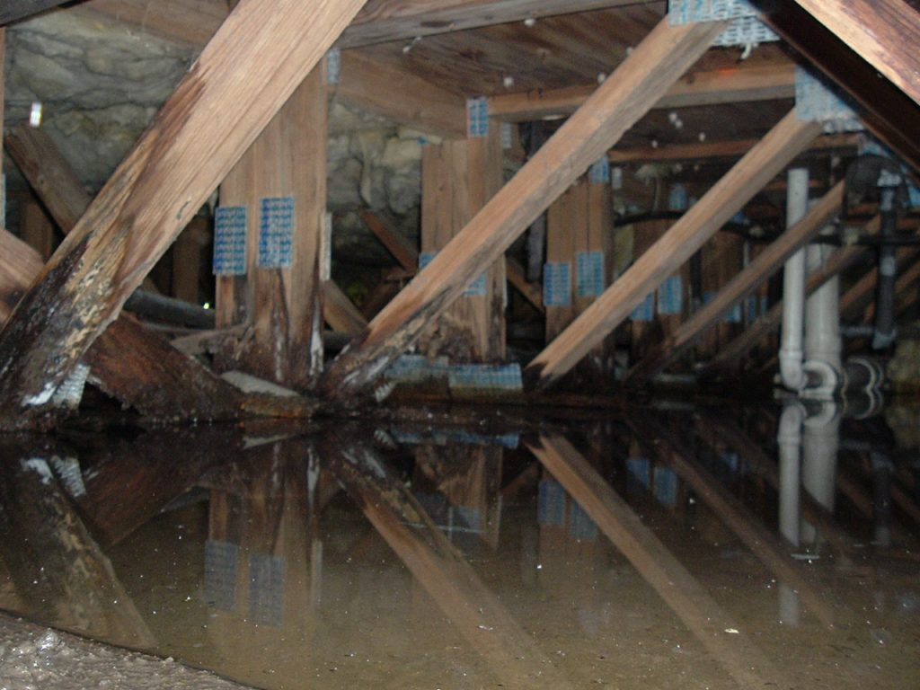 flooded crawlspace viewed during a home inspection